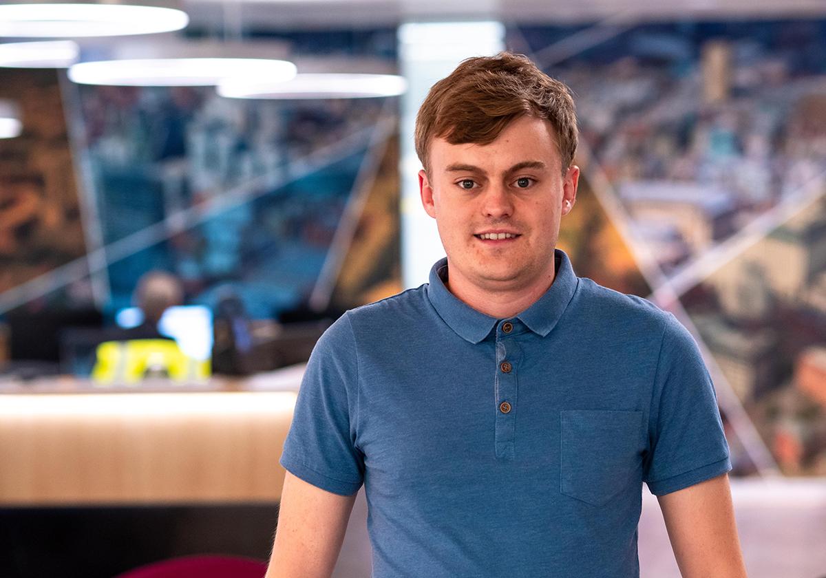 Software engineer Daniel Pomfret smiling at the camera