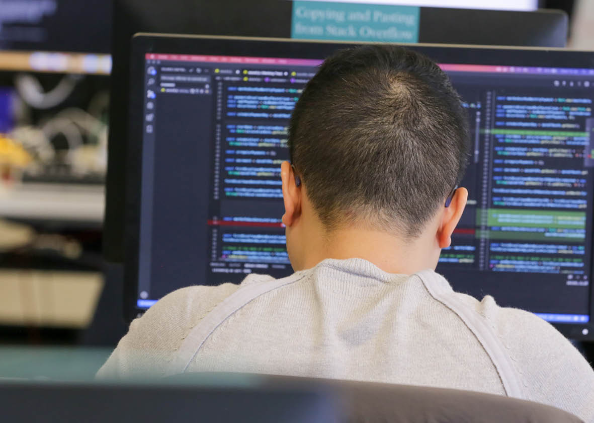 Person looking at code on a screen