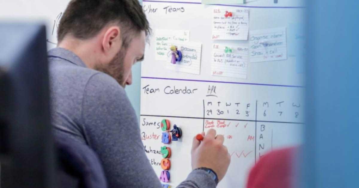 Man writing on whiteboard