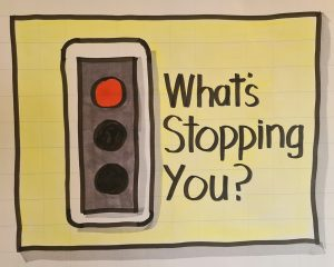 Illustration of a red traffic light and the words 'what's stopping you?'